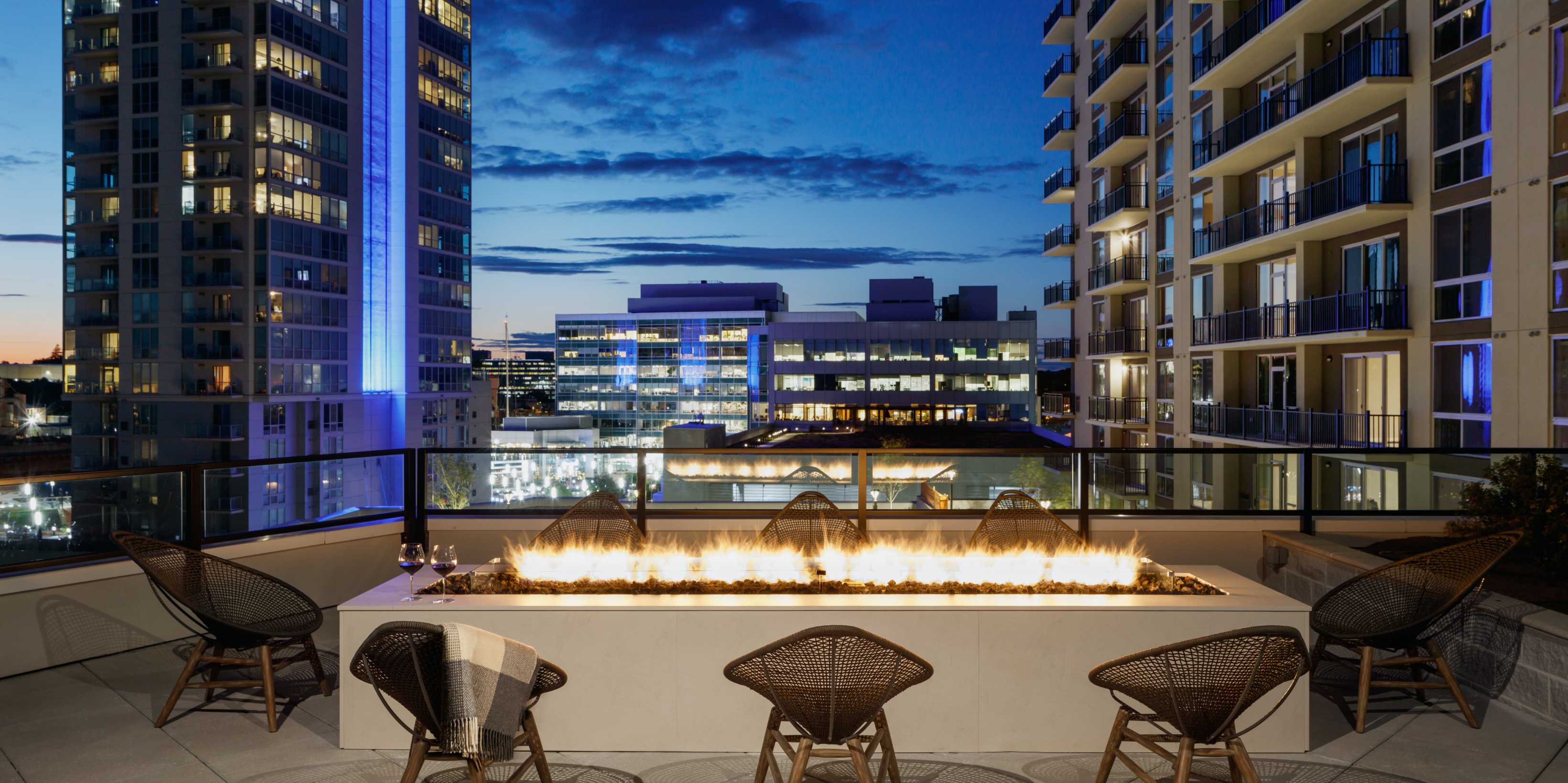 allure apartment firepit on rooftop at night in stamford