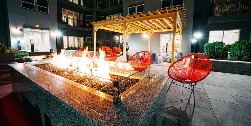 the curb apartments in norwalk with outdoor fire pit lounge blt
