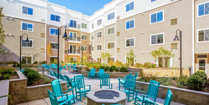 one glover norwalk apartments with resident courtyard and fire place